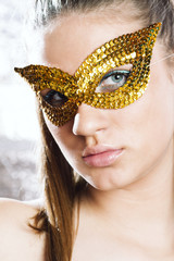 Cute young woman wearing mask