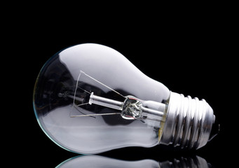 Photo of light bulb on black background.