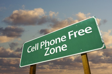 Cell Phone Free Zone Green Road Sign and Clouds