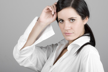 Dark Haired Business Woman Looking at Camera
