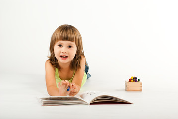 Cute little girl with drawing book