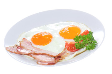 plate with fried egg, bacon vegetables