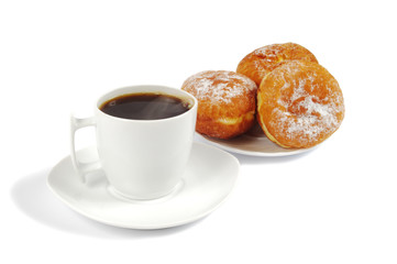 A cup of coffee and saucer with donuts