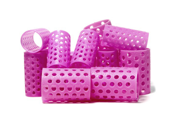 closeup of a few pink hair curlers
