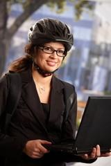 Businesswoman using laptop outdoors