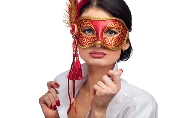 beautiful young woman wearing red carnival mask