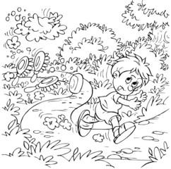 Boy running away along a path