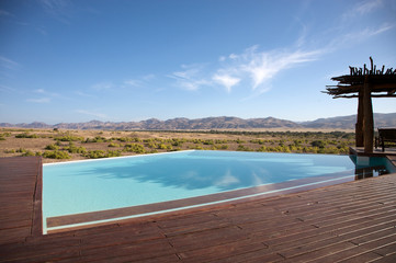 Luxury pool in a hotel and the desert of Namibia