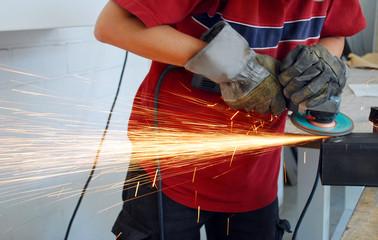 worker with grinder