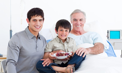 Smiling father and son visiting grandfather