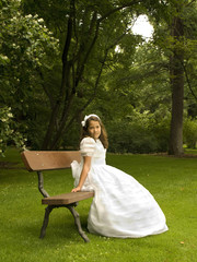Beautiful girl in her first communion day