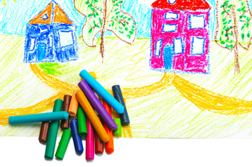 Wax crayons and a children's drawing.