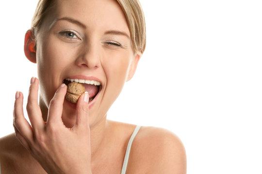 Woman with walnut winking