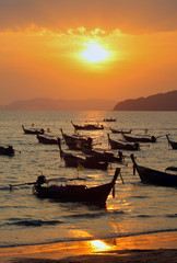 Longtail boats at sunset, Thailand