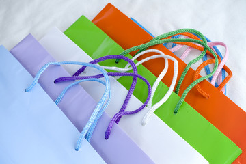 Assorted brightly coloured paper shopping bags