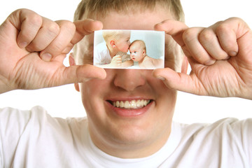 Man with card of kids on eyes, collage