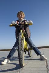 Boy on a bike on the promenade