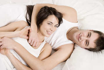 Young couple in bed.