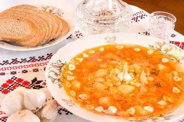 Ukrainian food - borsch, vodka, bread