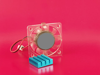 Fan and radiator on pink background