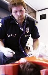 EMT working on patient on stretcher