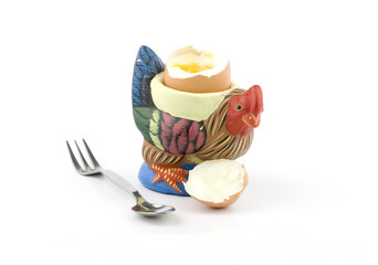 Rooster shaped egg holder with an egg
