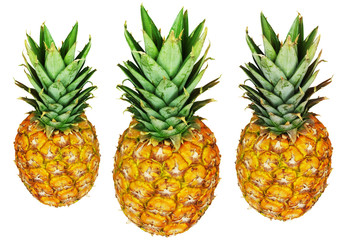 Three pineapples isolated on white