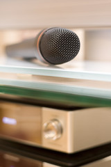 Microphone on Glass Shelf