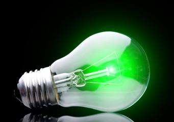 Photo of light bulb on black background.