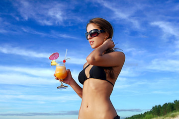 Beautiful woman with fresh summer cocktail