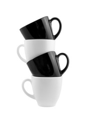 Black and white cups in stack isolated