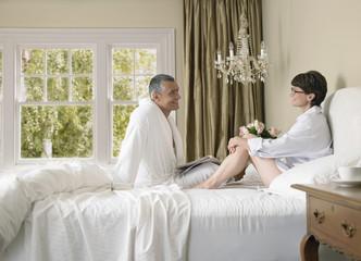 couple enjoying lazy morning in bed
