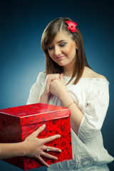 beautiful girl receives a gift