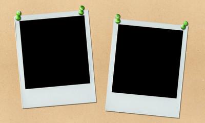 two polaroid photos hung on bulletin board