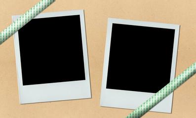 blank polaroid on bulletin board with ribbon