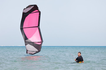 Kiteboarder lifting kite