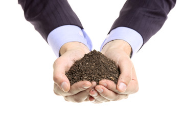 Hands holding a pile of soil isolated against white background