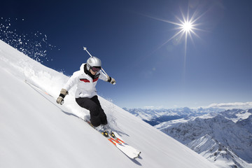 Female skier with sun