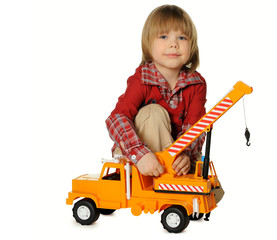 The little boy with a toy - a truck crane