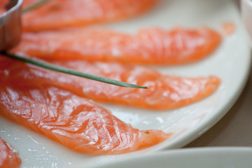 No sliced salmon rests on a plate