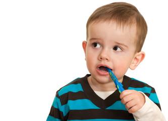 Toddler is brushing his teeth