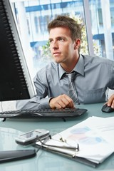 Businessman concentrating on work in office