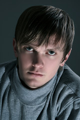 young man on dark wall background