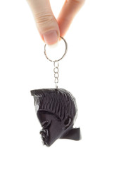 key ring with caved black wood