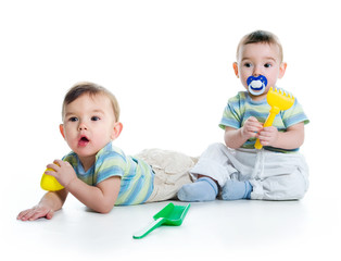 Two brothers with shovel and rake