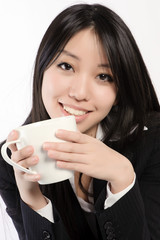 Girl drinking cappuccino