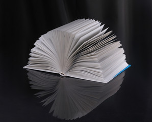 The open book on a dark background