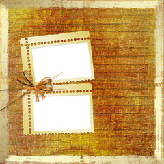 Old grunge photoalbum for photos with bow and ribbons