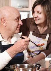 Senior couple preparing food