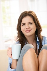 Smiling girl drinking coffee